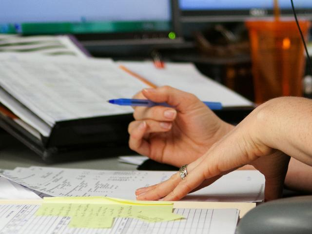 pair of hands looking over a report